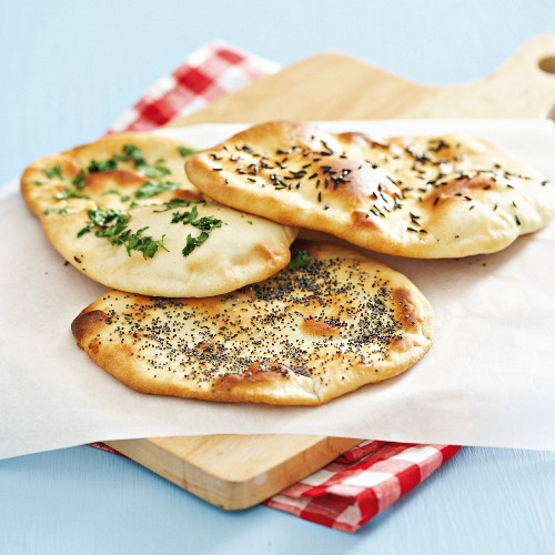 Naan bread with black caraway seeds, coriander and poppy seeds