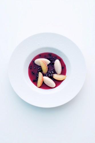 Elderberry soup with sweet semolina dumplings and apple
