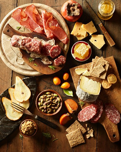 A supper of cold cuts, cheese, nuts and fruit