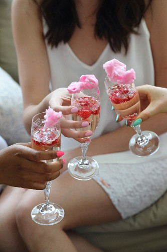 Sparkling wine with raspberries, pomegranate seeds and cotton candy