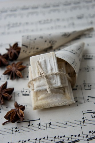 Springerle (anise biscuits with an embossed design) in a cone made from sheet music with star anise
