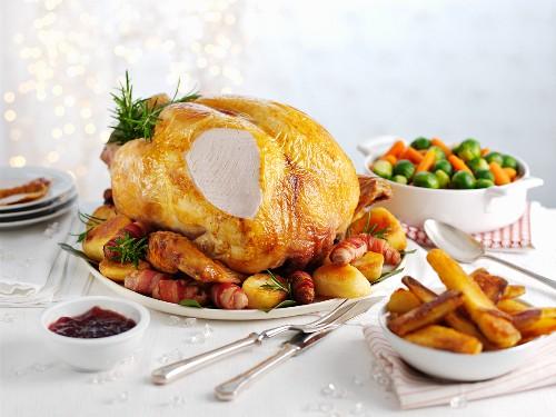 Sliced roast turkey with sides