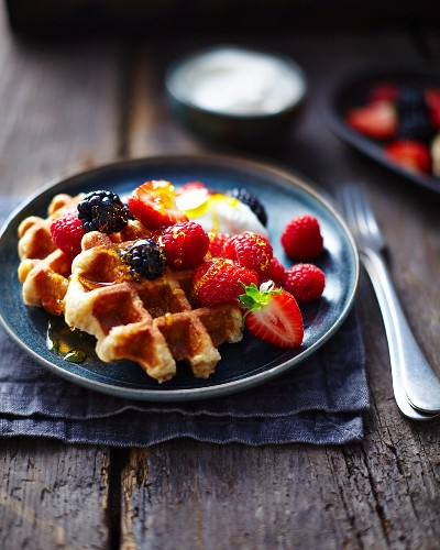 Waffles with vanilla ice-cream and berries