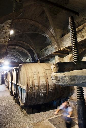 An old wine press in a wine cellar in Passopisciaro, Sicily, Italy