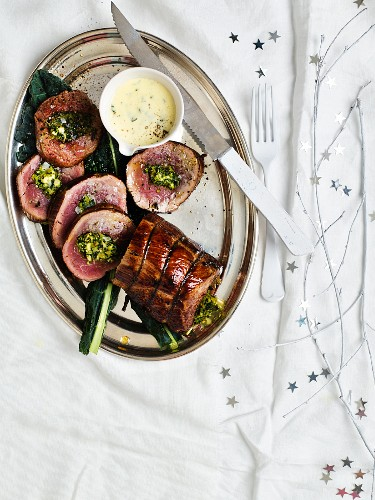 Beef fillet, filled with kale, almonds, feta cheese and Parmesan cheese served with parsley sauce (Christmas)