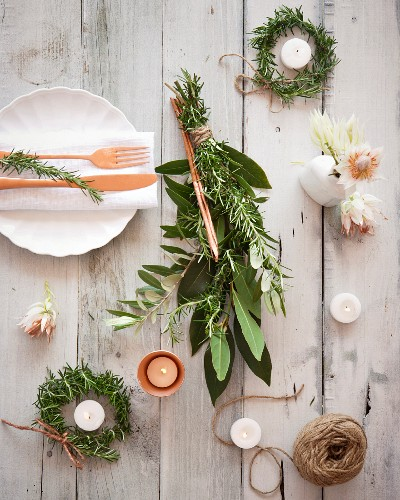 Table decoration with rosemary and candles