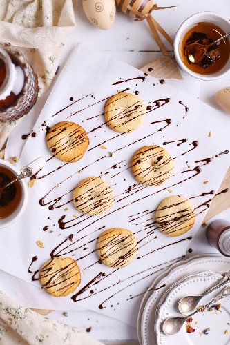 Coconut biscuits drizzled with chocolate sauce