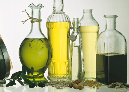 Assorted Oils in Glass Bottles