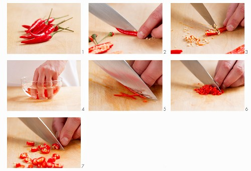 A chilli pepper being deseeded, sliced, cut into rings and chopped