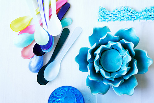 Plastic spoon and a flower heart (seen from above)