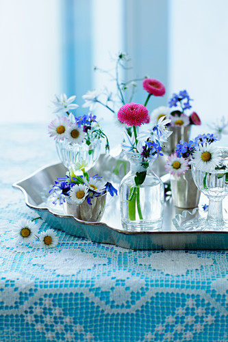 A bunch of spring flowers on a tray