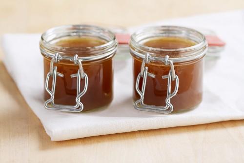 Demi glace (basic brown sauce) in jars