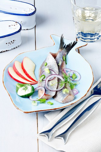 Dutch soused herring on a fish-shaped plate