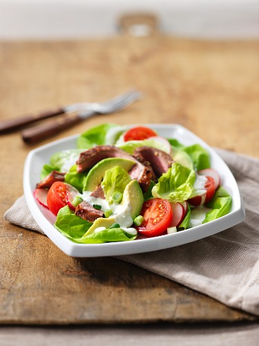 Vegetable salad with avocado and beef