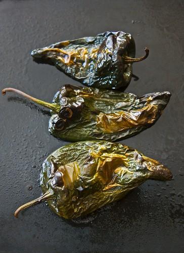 Roasted poblano chillis being peeled