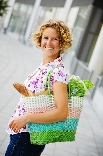 A woman with a shopping bag in the town