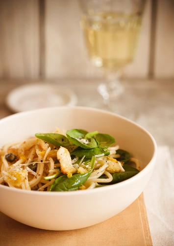 Bowl of Pasta with Baby Spinach and Shredded Parmesan Cheese