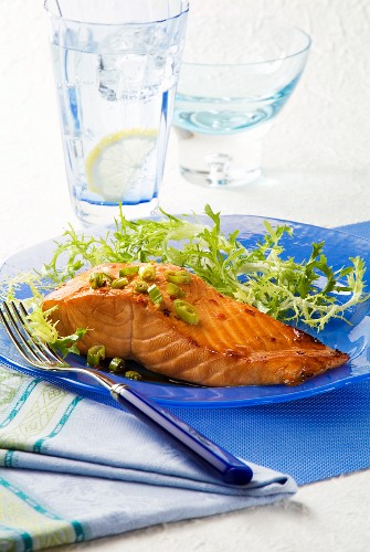 Marinated Salmon with Greens on a Blue Plate