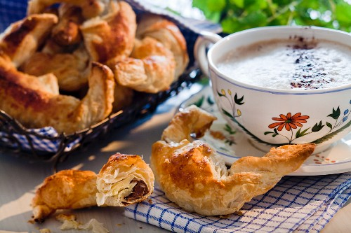 Chocolate croissant and cup of cappuccino