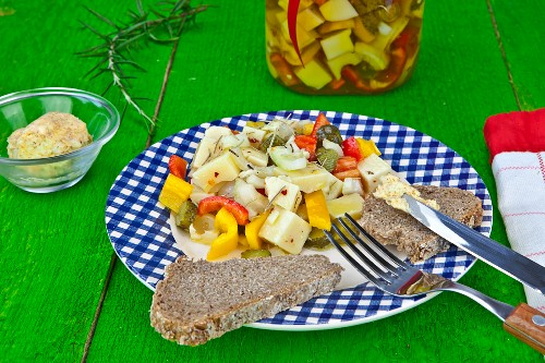 A supper of Swiss cheese, pickled in vegetables and olive oil with herb butter