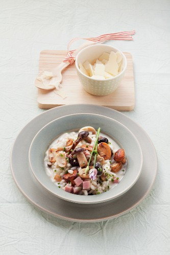 Risotto with mushrooms and ham cubes