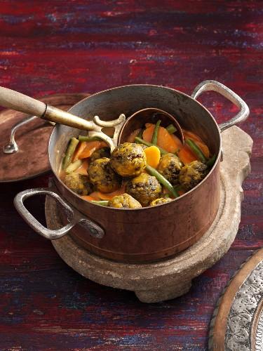 Pakistani lentil balls with braised vegetables