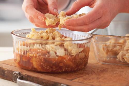 Preparing peach crumble