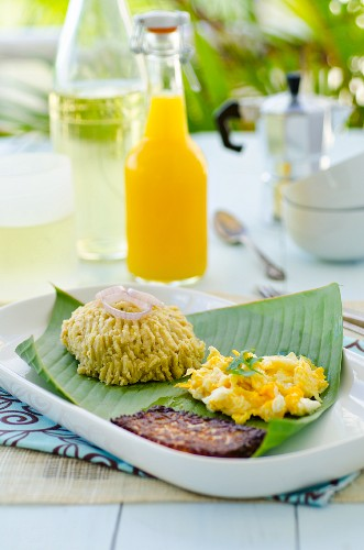Dominican breakfast: banana puree, scrambled egg and baked cheese