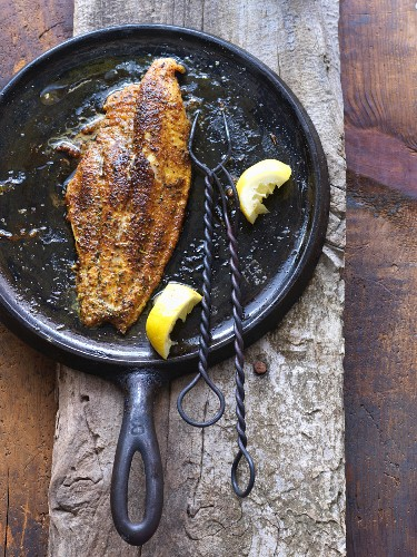Blackened Fish on a Cast Iron Skillet with Lemon
