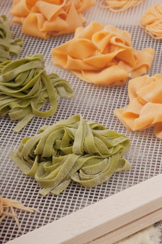 Pasta nests drying on a rack