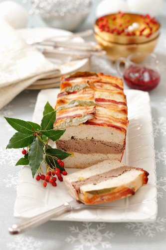 A chicken and liver meat loaf wrapped in pancetta