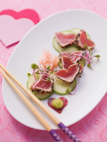 Flash-fried, heart-shaped tuna fillets on cucumber and marinated ginger