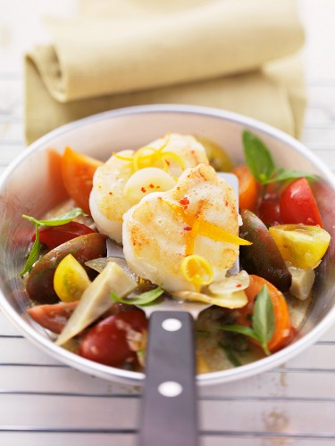 Monk fish with ginger on a colourful tomato salad