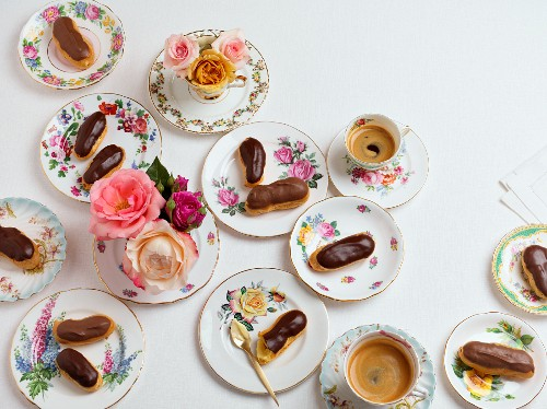 Eclairs with a chocolate glaze and coffee