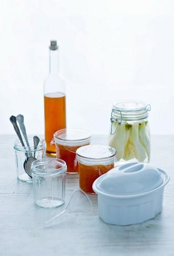 Marmelad, preserved vegetables, a bottle of vinegar and terrine