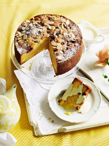 Raspberry cake with vanilla cream and slivered almonds
