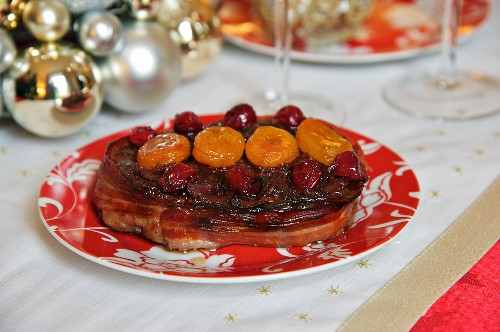 Beef steak wrapped in bacon with dried fruit