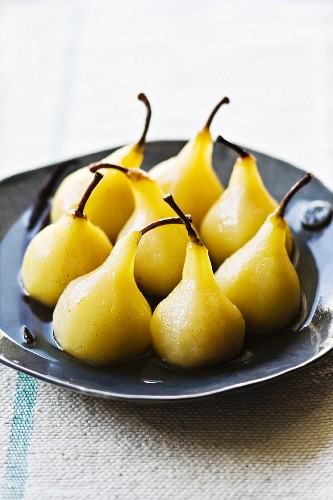 Poached pears in white wine syrup