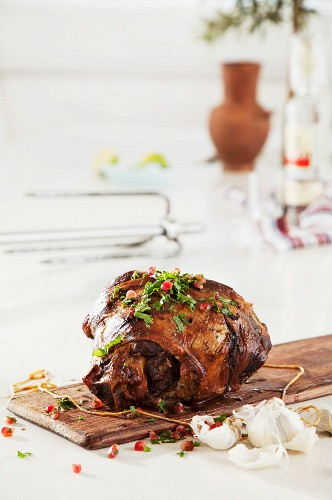 Leg of lamb with garlic, herbs and pomegranate seeds