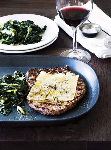 Bistecca all'asiago (grilled steak with cheese and chard, Italy)