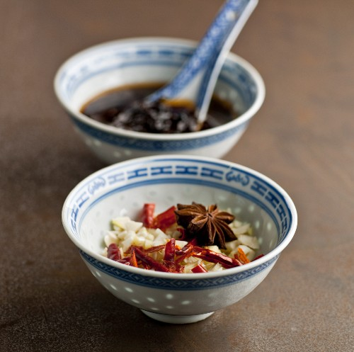Chinese Spice Bowl; Chopped Onion, Garlic, Red Pepper and Star Anise; Black Bean Sauce in Bowl in Background