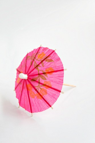 A pink cocktail umbrella
