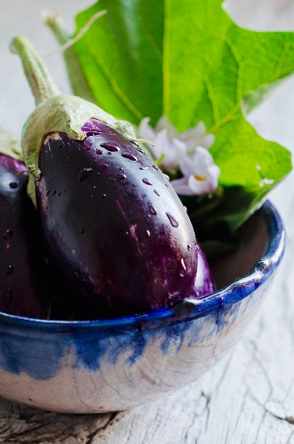 A bowl of freshly washed aubergines