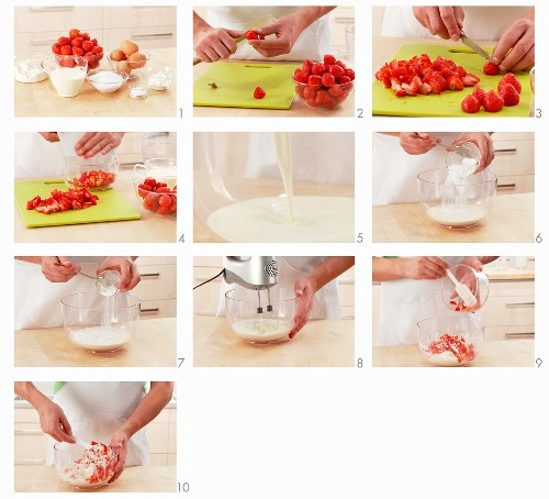 Strawberries with cream being prepared for a cake filling