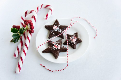 Chocolate star-shaped biscuits with candy canes