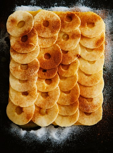 An unbaked apple and cinnamon tart