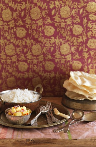 A table laid with rice, salad and unleavened bread (India)