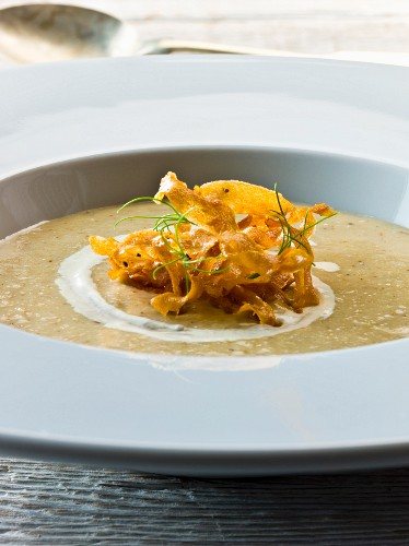 Cream of parsnip soup garnished with fried parsnips