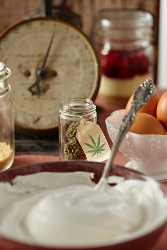 Cheesecake Filling in a Bowl; Marijuana Buds and Eggs