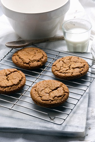 Fresh Homemade Molasses Cookies on a Cooling Rack; Glass of Milk